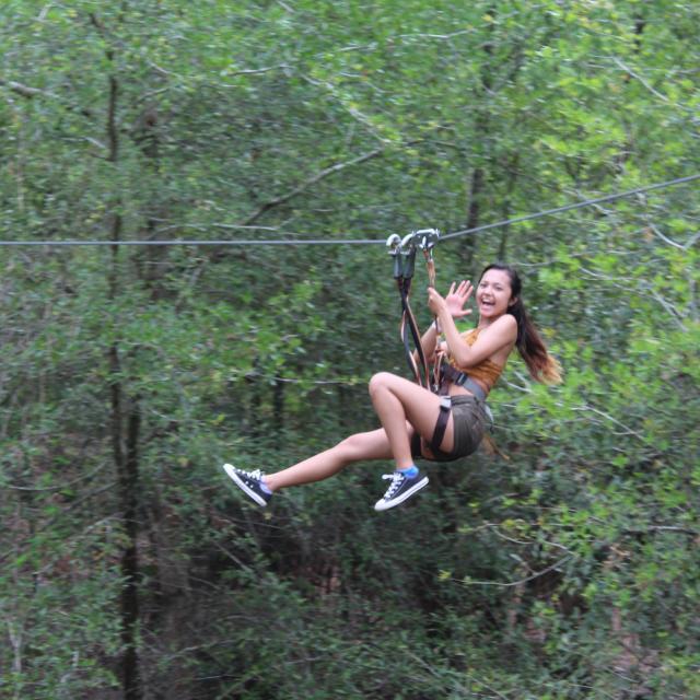 Orlando Tree Trek Adventure Park girl on zipline