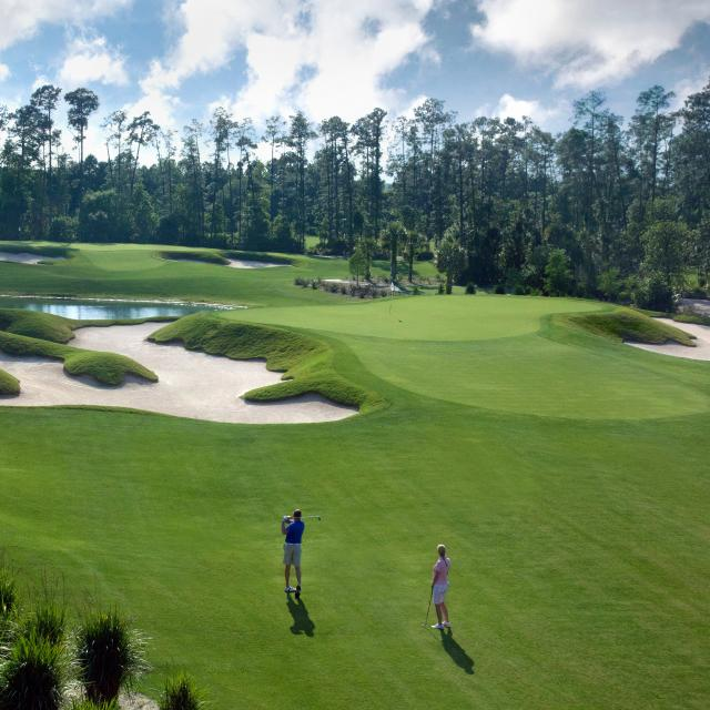 Aerial view of people golfing at the Waldorf Astoria Golf Club