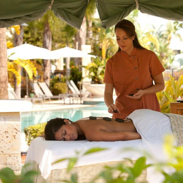 Eforea Spa at Hilton Orlando, woman getting a hot stone massage