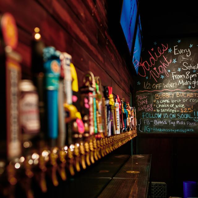 A picture of draft beer taps at The Twisted Handle in the Mills 50 area of Orlando