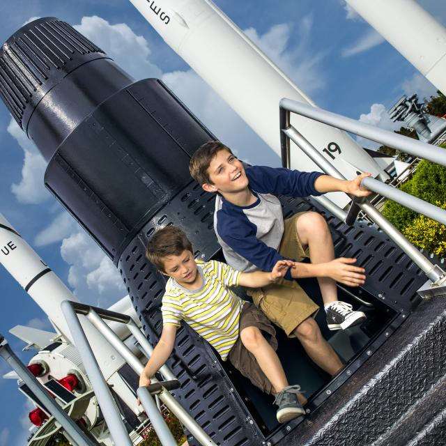 Kennedy Space Center Visitor Complex boys at rocket capsule