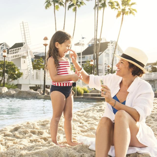 Disney's Yacht Club Resort mother and daughter on beach
