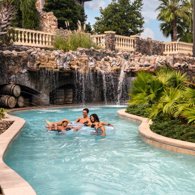 Family floating in the lazy river at the Four Seasons Resort at Walt Disney World Resort