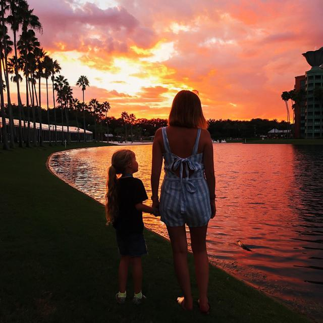 Influencer Katie Ellison and her family watch the sunset on a lake