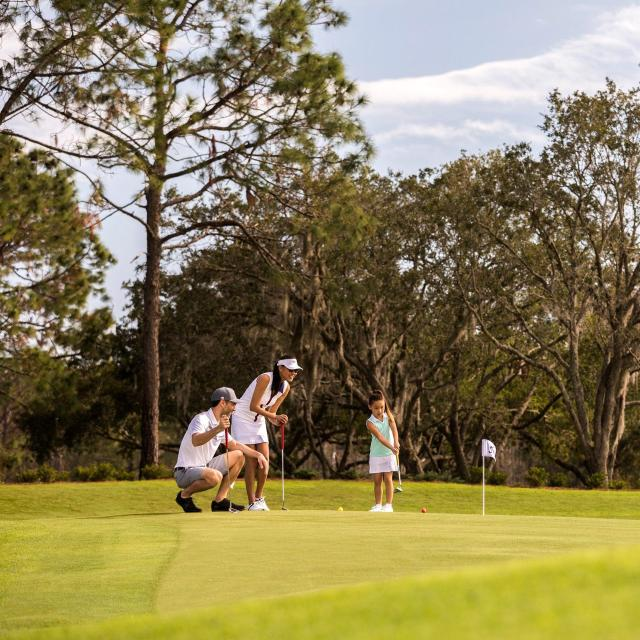 Tranquilo Golf Club at Four Seasons Resort Orlando family on putting course