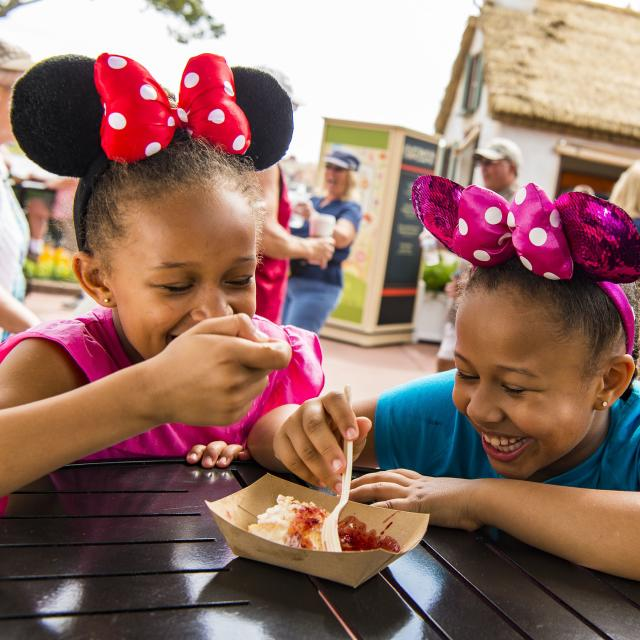 Epcot guests sample tasty bites from the Cider House Outdoor Kitchen during the Epcot International Flower & Garden Festival. The festival features dozens of character topiaries, stunning floral displays, gardening seminars and the Garden Rocks concert series.