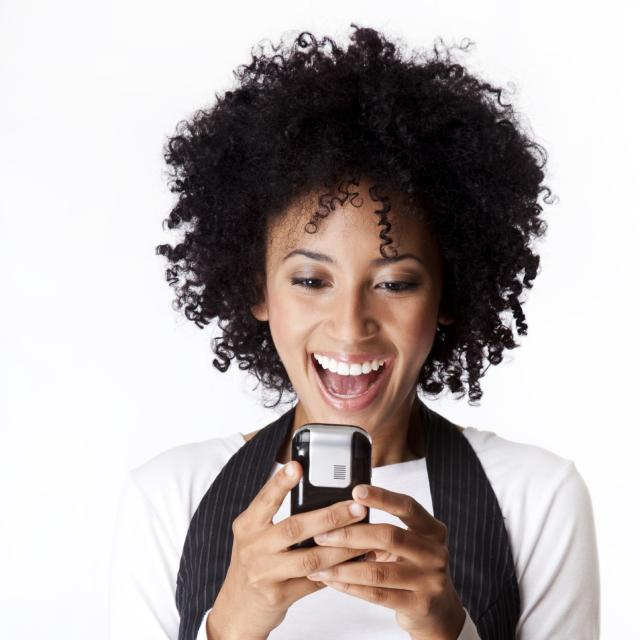 african american woman looking at her cell phone