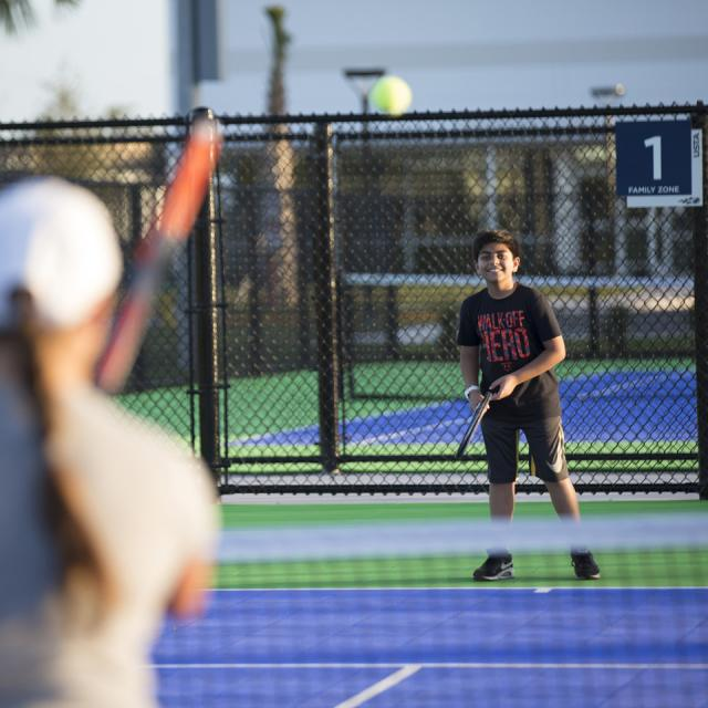USTA National Campus boy playing at Nemours Family Zone