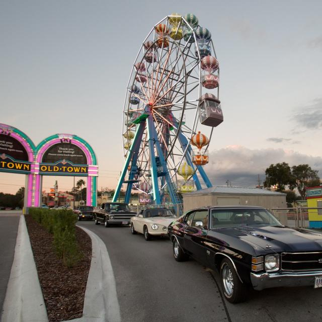 Old Town classic cars and Ferris wheel at dusk