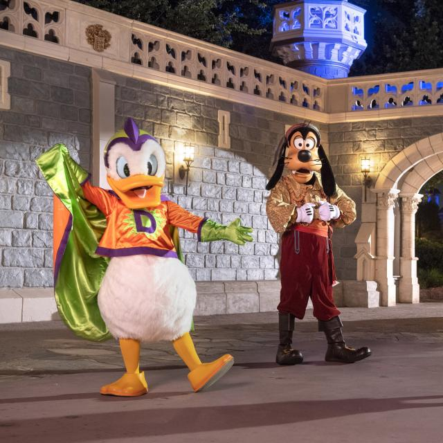 Goofy, Donald and Daisy posing in Halloween costumes at Disney's After Hours Boo Bash