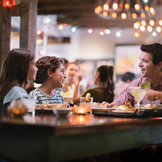 A family of four dining at Uncle Julio's at ICON Park on International Drive in Orlando, Florida.