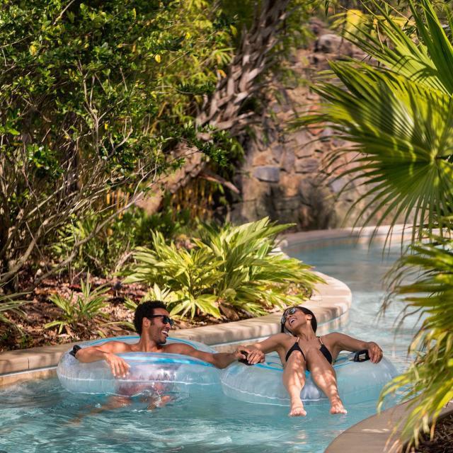 Four Seasons Resort Orlando at Walt Disney World® Resort lazy river couple