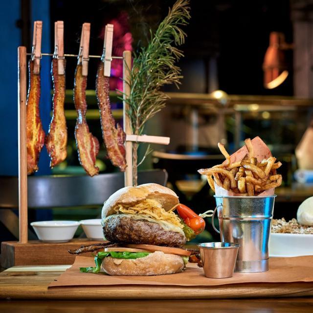 Hamburger and fries at The Edison at Disney Springs