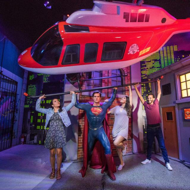 Group poses with Superman at Madame Tussauds