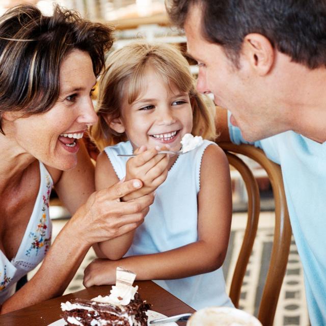 Family eating dessert at a restaurant