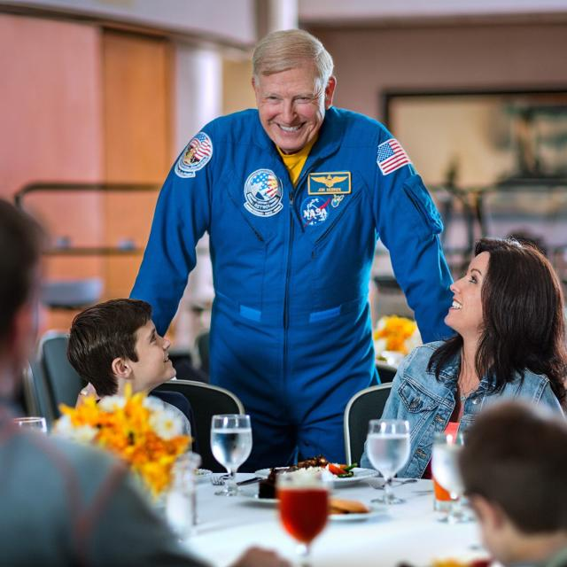 Kennedy Space Center Visitor Complex astronaut with family at meal