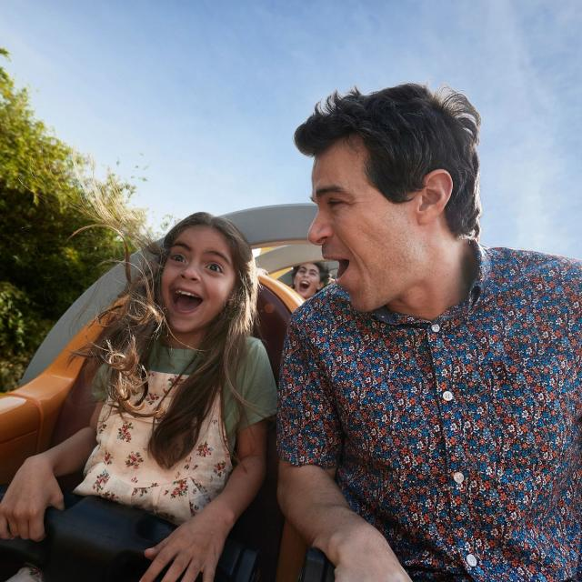 A father and daughter on a Rollercoaster