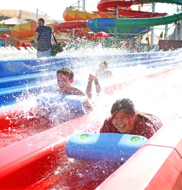 Z Fun Factory 2 kids coming down red water slides