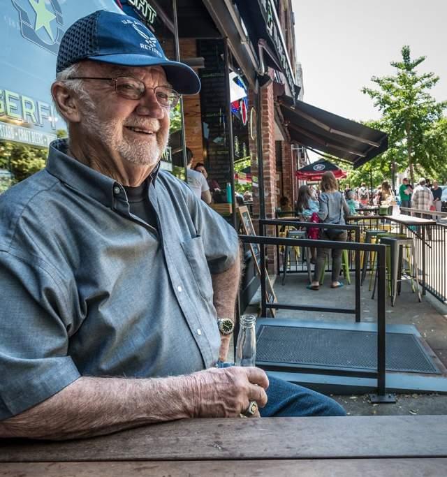 Man on Mass Street enjoying a beer