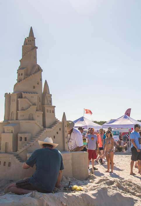 People browse sand castle creations at Texas Sandfest
