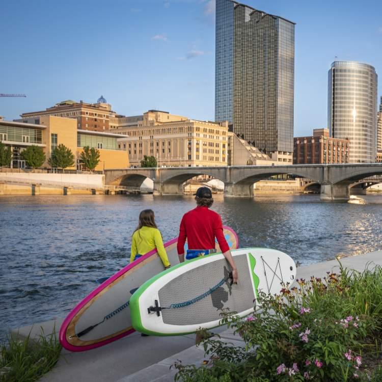 Paddle boarders walking downtown Grand Rapids, Michigan