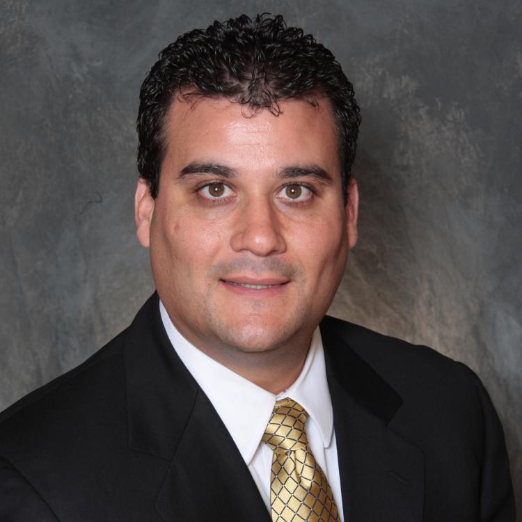 Headshot for 2021 Visit Orlando Board of Director Chris Mueller