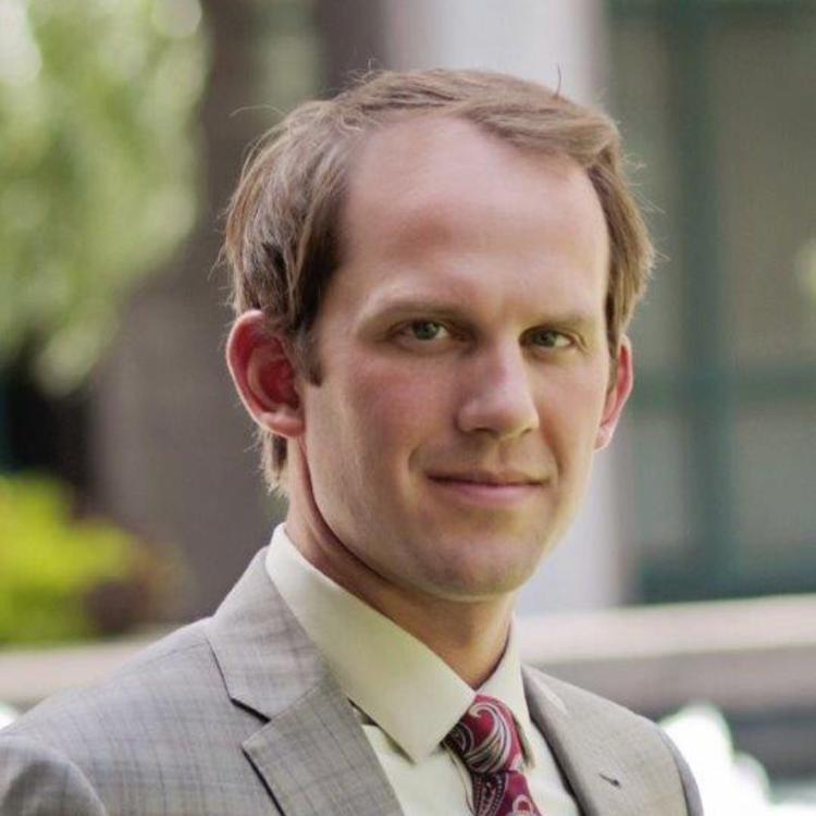 Headshot for 2021 Visit Orlando Board of Director Evan Wyant