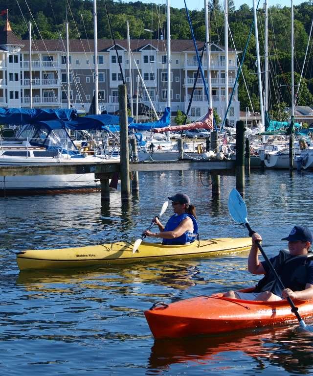 People Kayaking in Harbor
