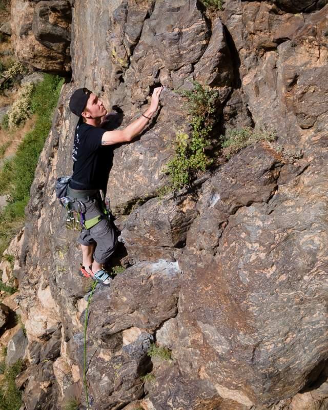 Man Rock Climbing Outdoors in Golden, CO