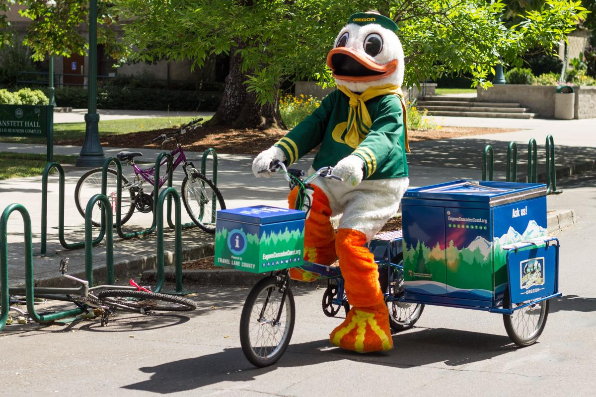The Duck riding MIKE the BIKE on the University of Oregon campus