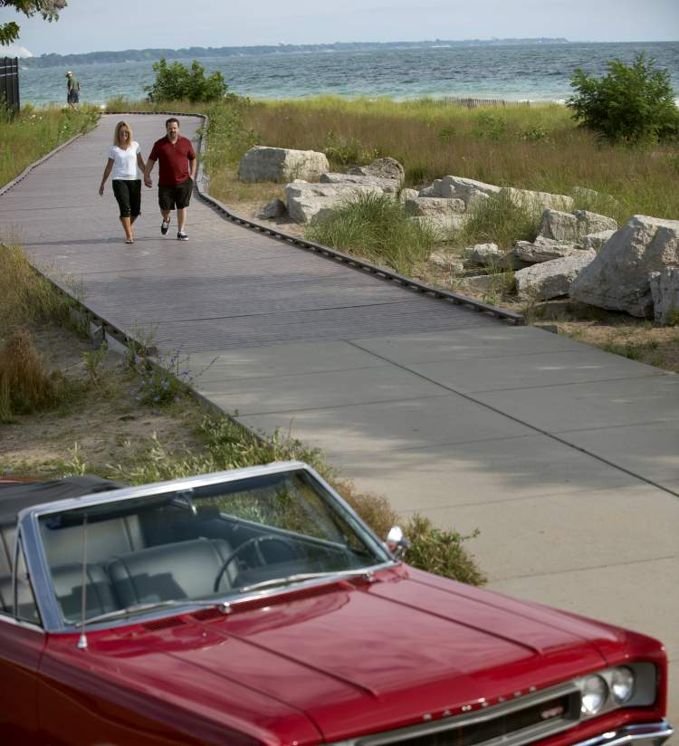 Couple Holding Hands & Red Convertible