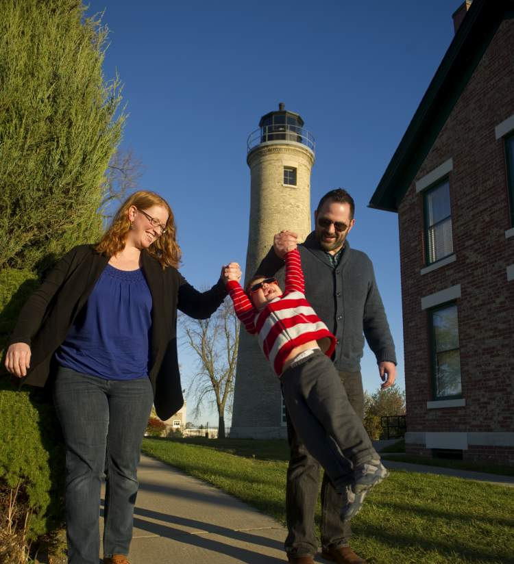 Family in front of Southport Lighthouse