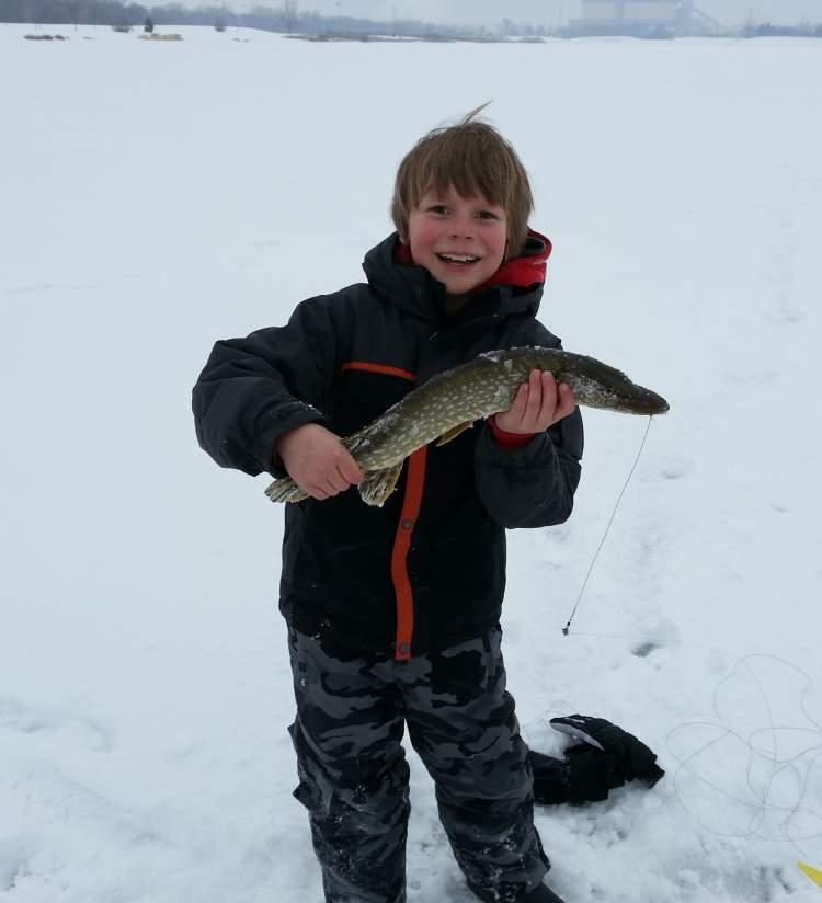 A kid ice fishing