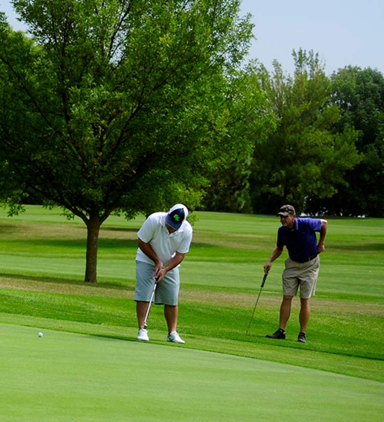 Men golfing in Kenosha County at Petrifying Spring Golf Course