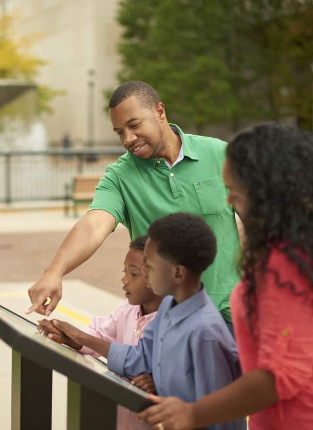 Family Looking at Map at Capital Mall