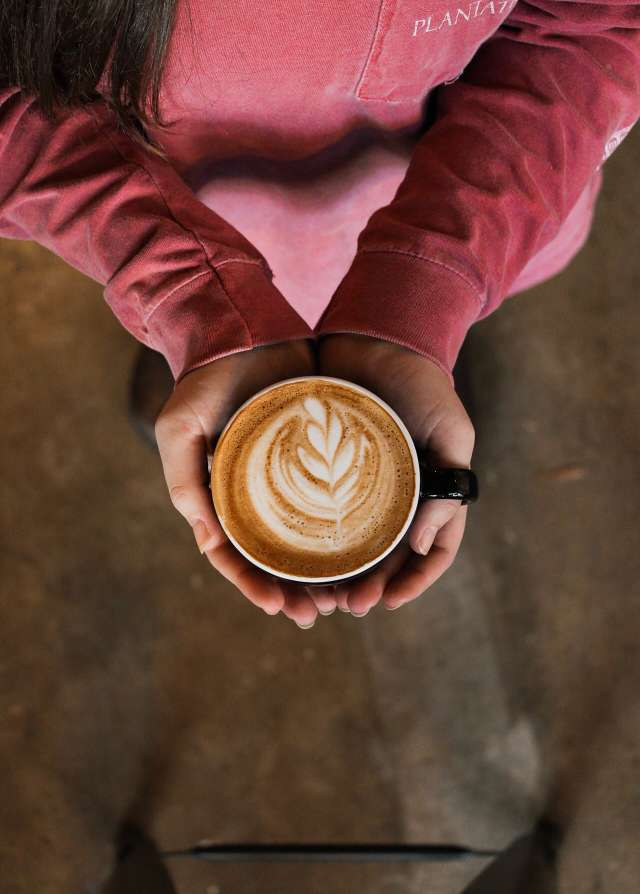 Person Holding Flat White Coffee