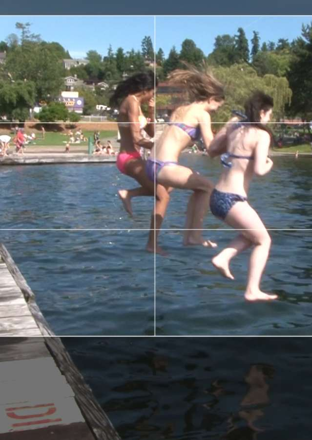Girls jumping into lake