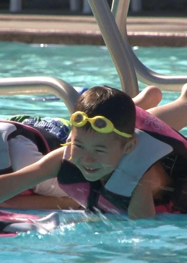 Multi cultural children in swimming pool