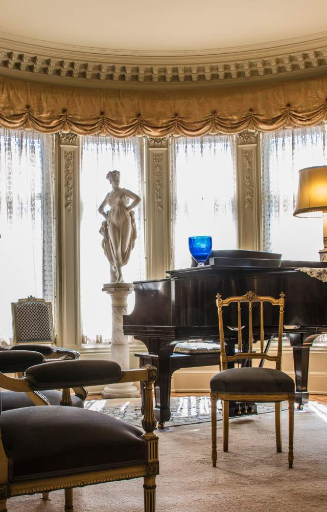 A photo of the music room inside the historic Oliver Mansion