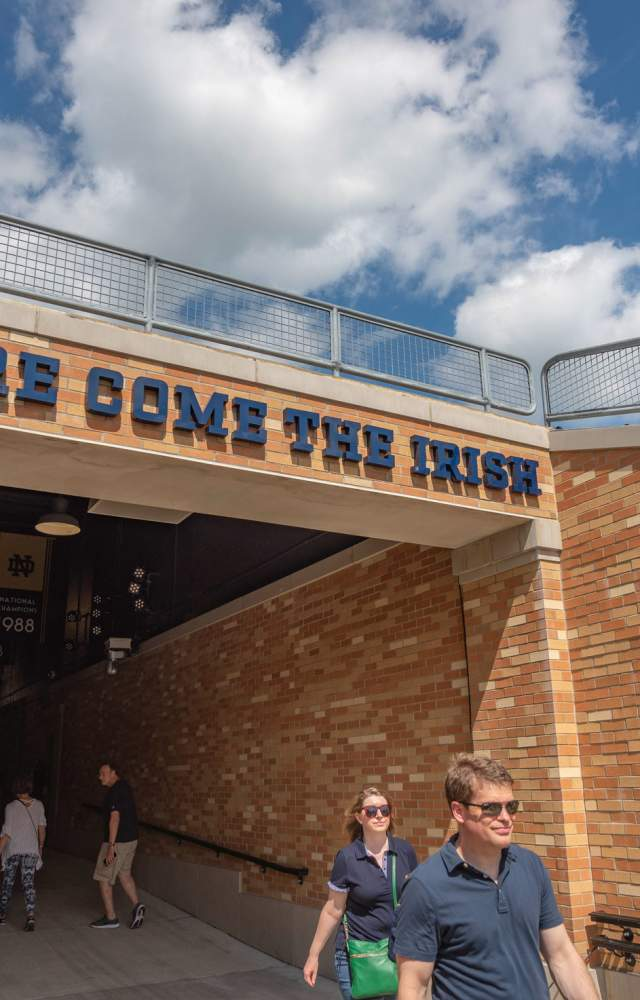 Visitors walk thru the tunnel to tour the football stadium at the University of Notre Dame
