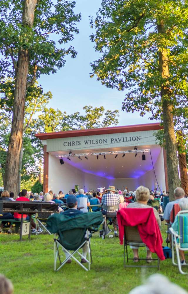 Visitors enjoy an outdoor concert at the Chris Wilson Pavilion in Potawatomi Park