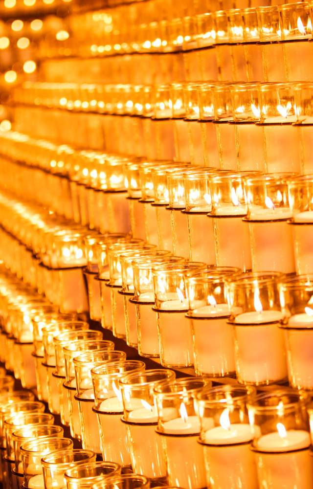 A close up photo of candles at the Grotto on the University fo Notre Dame campus