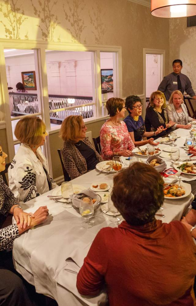 A group of ladies enjoy dinner at Cafe Navarre in downtown South Bend