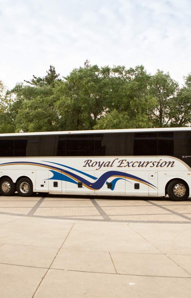 A Royal Excursion bus for groups traveling around The Bend during their visit