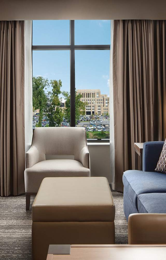 A hotel room at Embassy Suites with views of Notre Dame campus from the window