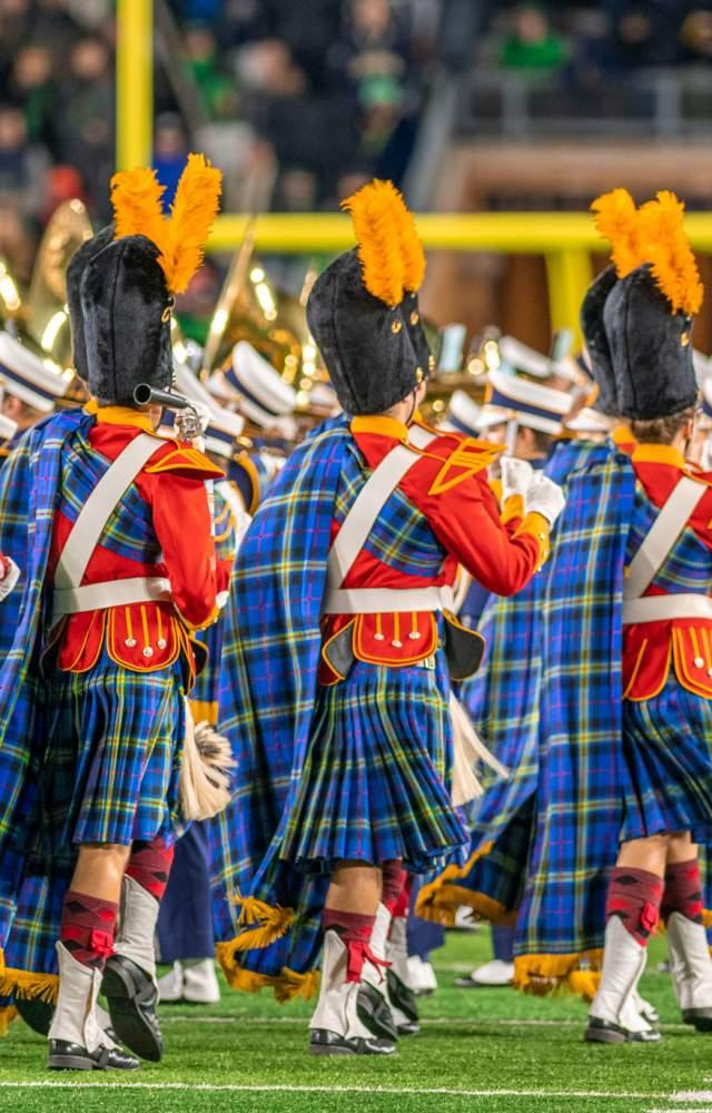 The Irish Guard walking along the field in the football stadium