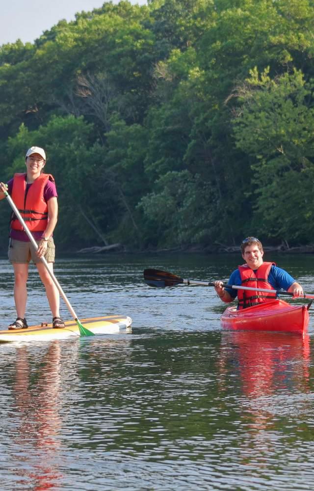Visitors enjoy a kayak and paddle board at St. Patrick's County Park