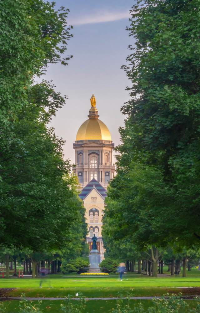 Students walking to class with the Golden Dome in the background