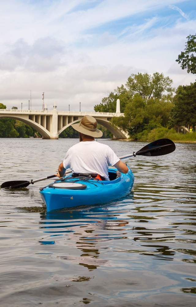 A kayaker glides down the St Joseph River