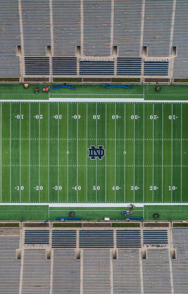 An aerial shot of an empty football stadium at the University of Notre Dame